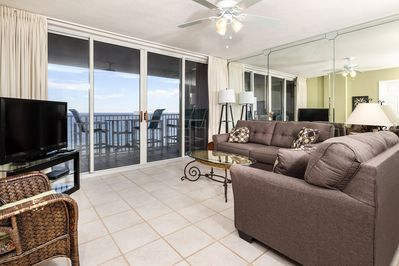 Gulf front living area  - Living Room has clean tile flooring, large flat screen and again breathtaking views