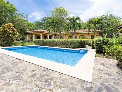 Photo for Spacious estate pool home, 7 BR, Walk to beach and town!