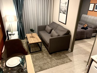 Photo for 5mins to MRT Cozy brand new apartment with big garden pool,style decoration