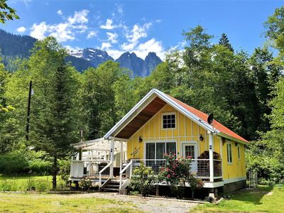 Photo for Charming cottage w/ stunning mountain views, spacious yard, outdoor living area w/ hot tub, WiFi