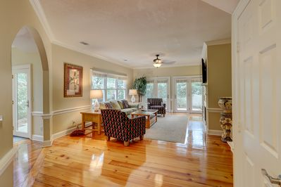 Enter this gorgeous town home to find beautiful heart pine floors and an open living space