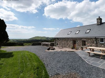 Photo for This stunning Tywyn holiday cottage is in an idyllic location and is packed with traditional feature