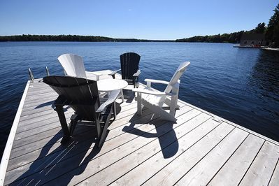 Large dock with great views. Muskoka chairs to sit and relax on the water