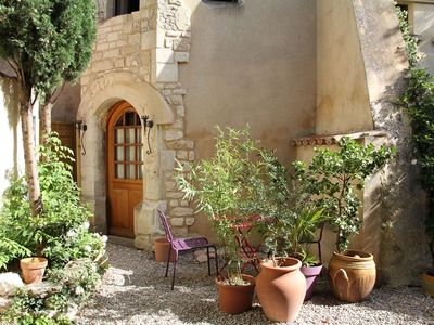 Photo for Atypical cottage with medieval tower and flowered courtyard at 5mn Isle sur la Sorgue
