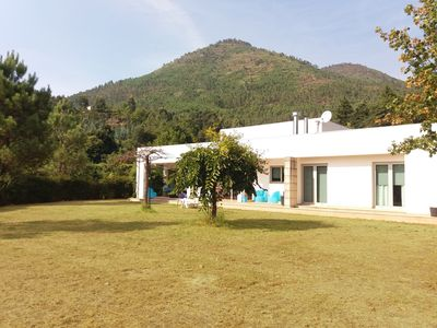 Photo for Modern villa, set in a green spot, ideal for families or groups.