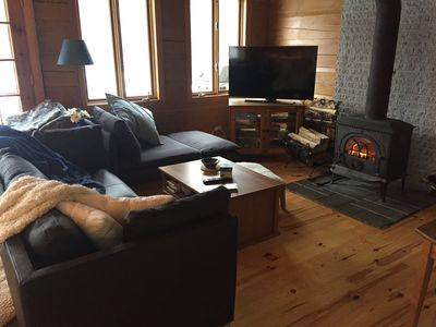 wood burnning fireplace in living room.