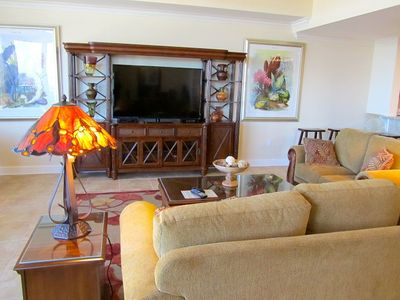 Large Living room with 60' Flat Screen HD TV with DVD and Stereo