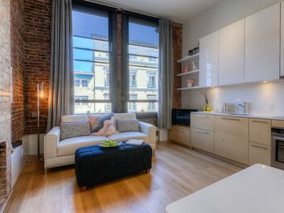 Photo for Stylish Waterfront Loft in the heart of downtown!