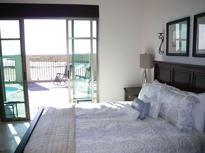 2nd Bedroom with patio doors, view of our large pool and the estuary