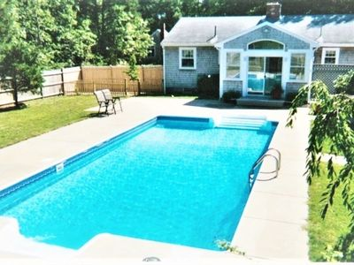 Photo for Private 4BR house + 2 BR Cottage+ heated pool @ entrance to Coast Guard Beach