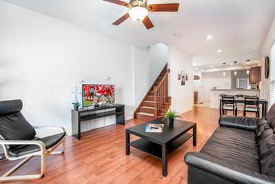 Bright Spacious Living Room. Tall Ceilings. Open Concept. 4K TV w/ ROKU