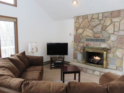 GREAT LIVING ROOM WITH WRAP AROUND COUCH, FLAT SCREEN LED TV AND GAS FIREPLACE