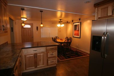 Spacious kitchen & dinning area  Seats 9 plus extra table & 4 chairs in closet