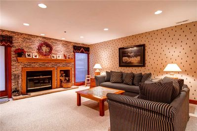 Cozy wood burning fireplace sleeper sofa - ParkCityLodging_SilverCliffVillage103_Living_1