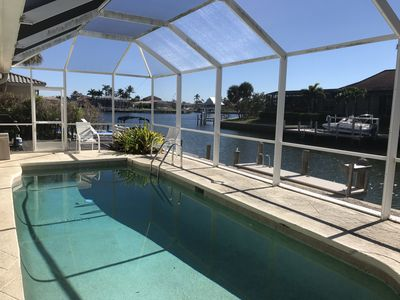Photo for Awesome house!  5  minute walk to beach, on canal heated pool Open Christmas ,