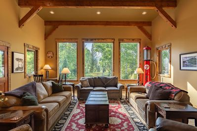 Walk into the grand great room with large windows to view wildlife and sunsets.