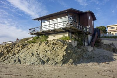 This iconic oceanfront cayucos beach home sits directly over the sand