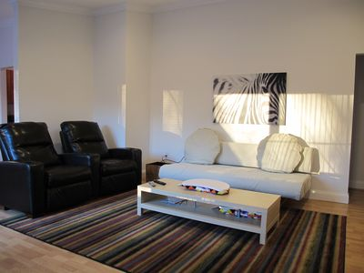 Clean, Bright and comfortable! Spacious living room; recliners, comfy couch!