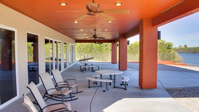 Patio w/shade, picnic tables, rocking chairs, grill and hammock.  A great view