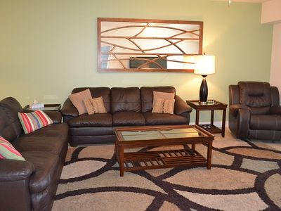 Photo for Tastefully decorated 3/2 condo with beautiful sneak peaks of the ocean.OW13-204