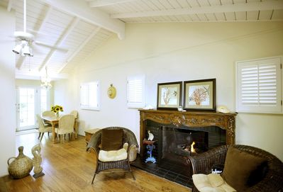 Open beam ceilings and plantation shutters throughout add to bright airy feeling