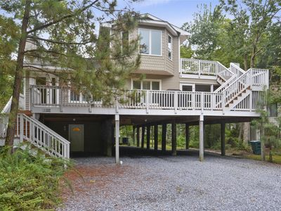 Photo for FREE ACTIVITIES INCLUDED!!  This large 6 bedroom vacation home with 4 full and 1 half baths is the perfect peaceful retreat.  Located in a quiet residential neighborhood with two community pools plus kiddie pool, tennis and playground,