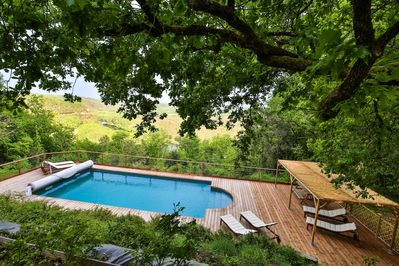 pool deck with Dordogne river