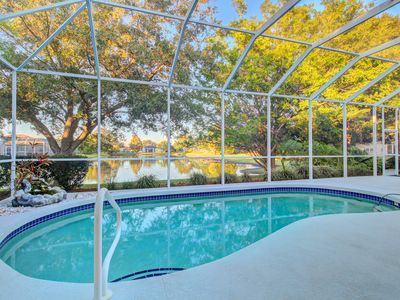 Photo for Lakefront gated community home with private heated pool.