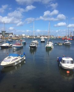 Photo for Stylish family cottage with stunning views of Brixham harbour. Dogs welcome.