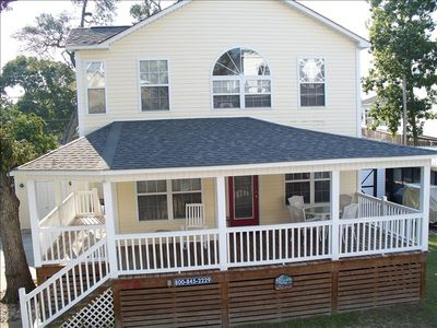 Two story house with large porch for dinning or relaxing in the sun.