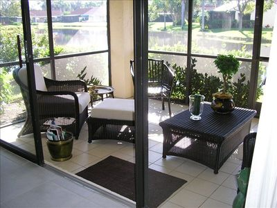 Screened lanai. There is a view of fountain in lake.