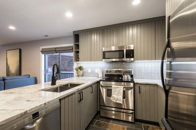 Remodeled Kitchen with Stainless Steel Appliances, and Ample Quartz Countertops for Meal Prep and Entertaining