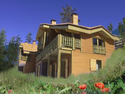 Photo for Comfortable, traditional wooden chalets near the slopes