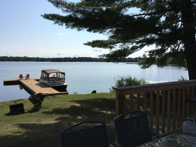 Photo for The Beach House, Super cute bright cottage with deck on the lake, includes BBQ & fire pitt