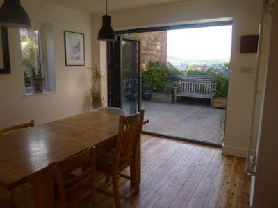 The living room / dining area with bi-folding doors out onto the decking.