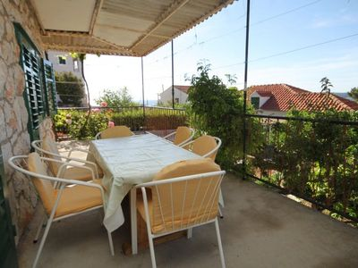 Photo for Two bedroom apartment with terrace and sea view Zavala, Hvar (A-8802-c)