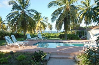 View from the porch. Pool and gazebo with ocean views.