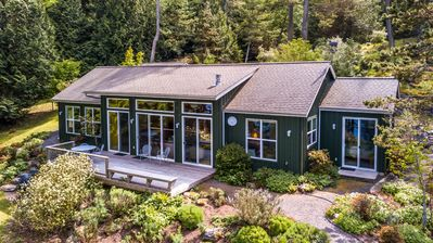 Lovely Casa Verde waterfront view home on Orcas Island.  Wonderful private setting with beautiful landscaping and views.