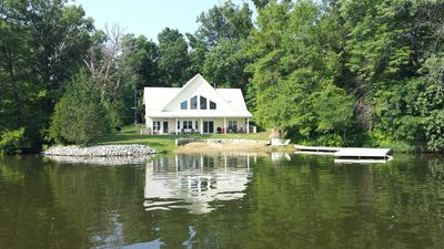 View of house from lake Beach and boat dock