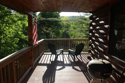 Only one mile to Okemo on 2 lakefront acres. Great views from wrap around deck!