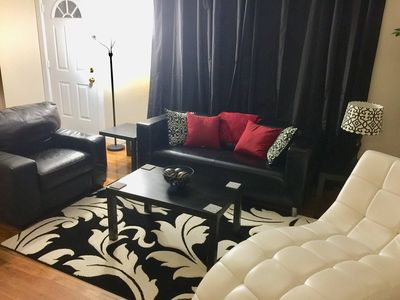 Living room includes leather sofa, chair and chaise.