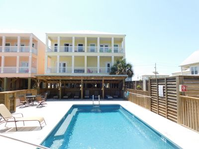 Photo for Mellow Yellow Home with Volleyball Court, Community Pool, and Private Cabanas!