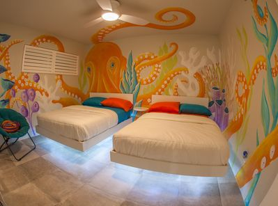 Award winning artist mural and 2 full size FLOATING BEDS! For Kids of all ages!