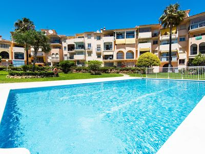 Photo for Air-Conditioned Apartment Close to Beach with Rooftop Terrace, Pool & Wi-Fi; Parking Available, 1 Pet Allowed