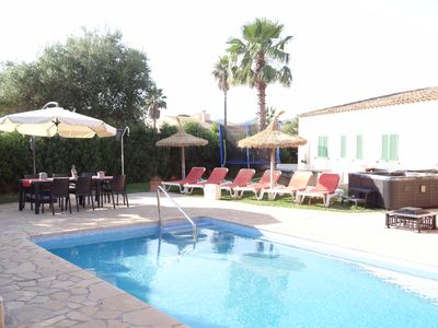 Heated pool, Hot Tub, Table Tennis, Trampoline and lots of seating