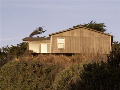 Perched on the sand dunes with views to the beach and creek.