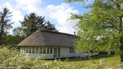 Photo for Well maintained stone house with thatched roof in the countryside