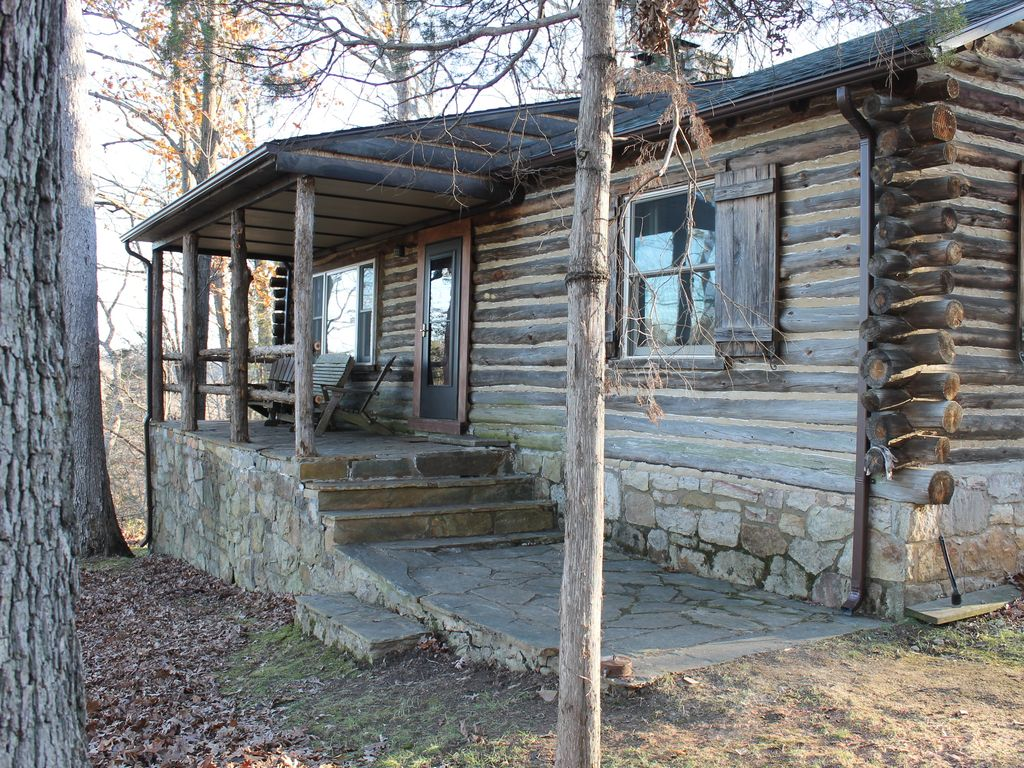 rustic mountain log cabin perched on a clif - vrbo