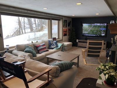 """A 70"""" HDTV awaits in the downstairs living room."""