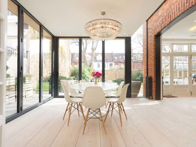 Photo for Beautifully light and airy 5 bed family home located in boutique Chiswick- Veeve